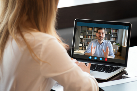 Student attends a virtual meeting with a male staff member.