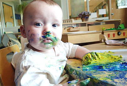 Child with paint on face