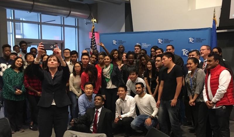 Tulsa Community College, Tulsa, Oklahoma: international students taking a picture with Tulsa Community College President, Dr. Leigh Goodson