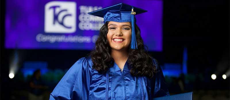 TCC graduate in cap and gown