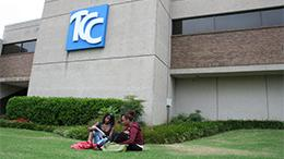 Student sitting on the lawn studying at the TCC Northeast Campus