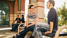 TCC West campus students sitting outside talking