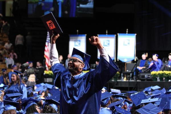 A TCC graduate celebrates following commencement