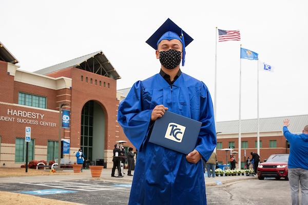 TCC student in cap and gown at commencement