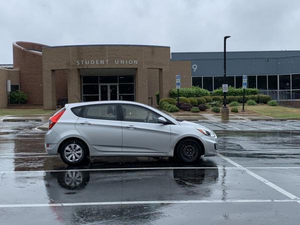 TCC student doing coursework from vehicle with parking lot WiFi access