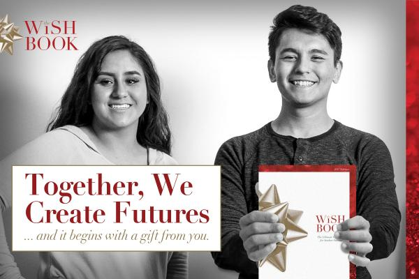 photo of two students, one is holding the 2017 Wish Book