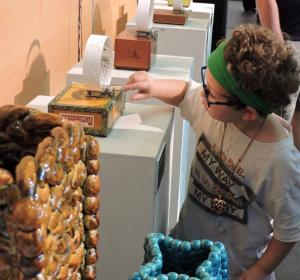 Children touch the art during the 2016 Please Touch the Art exhibit at the Thomas K. McKeon Center for Creativity on the TCC Metro Campus.