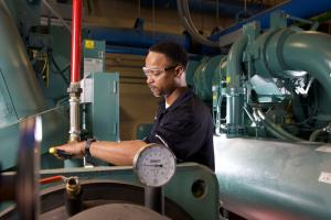 tcc employee working on HVAC equipment