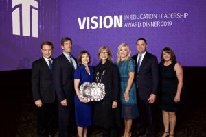 photo of seven people including TCC President and 2019 Vision honoree