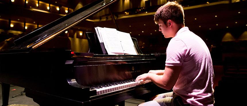 Student playing piano.