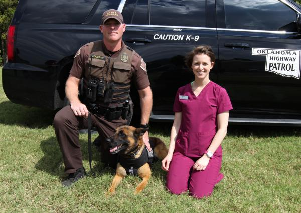 Vet Tech student Cairlin Lewis with a State Trooper and his dog Marko